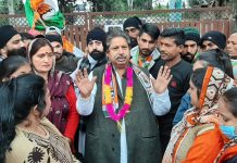 Senior Congress leader, Raman Bhalla addressing a public gathering in Satwari area on Monday.