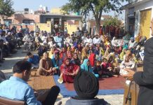 Senior NC leader Surjeet Singh Slathia addressing a public meeting in Vijaypur area of Samba district.