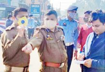 SSP Traffic Shiv Kumar Sharma passing directions to cops during his visit to a busiest area of Jammu City.