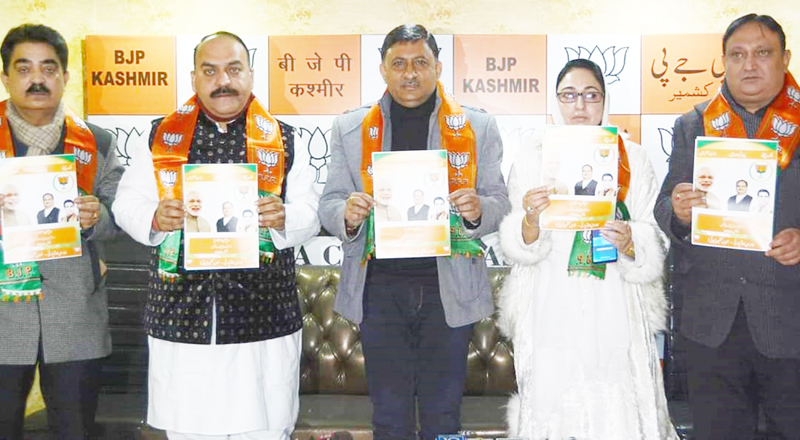 BJP leaders releasing party's vision document at Srinagar on Sunday. —Excelsior/Shakeel