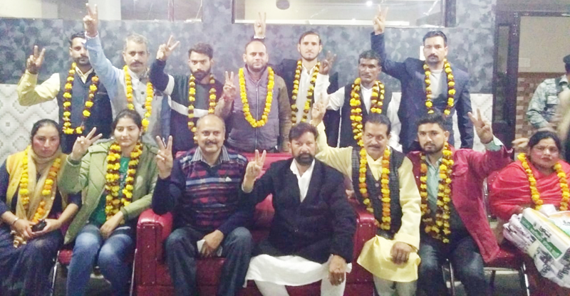 DSSP chief Ch Lal Singh posing with new entrants of the party at a public meeting in Jammu.