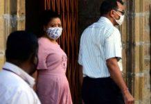 Comedian Bharti Singh being taken by Narcotics Control Bureau officers for medical examination at Ballard Estate, in Mumbai.