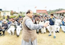 NC Provincial President Devender Singh Rana addressing a public gathering in Nagrota constituency on Tuesday.
