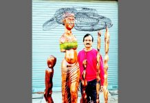 Artist Ganesh Sharma with his sculpture.