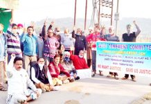 Members of JTC and SKF raising slogans during protest at Jagti Township.