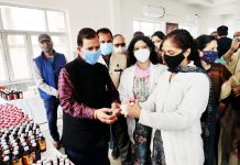 A doctor giving medicine to a man at an Ayurvedic medical camp in Jammu.
