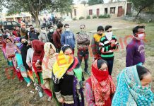 People wait in long queues to cast votes in Marh seat of Jammu district on Friday. -Excelsior/ Rakesh