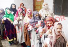Women voters in a queue at Gultibagh in Ganderbal district on Friday. -Excelsior/Shakeel