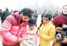 Cricketer Suresh Raina giving autograph to young budding players at Anantnag. -Excelsior/Sajad Dar