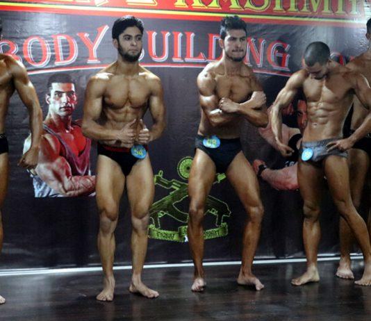 Bodybuilders in action during Sher-e-Kashmir event, organised under Sadhbhavana by 20 RR at Srinagar on Wednesday. -Excelsior/Shakeel