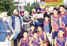 Winning team posing for group photograph with trophy along with dignitaries at Jammu.