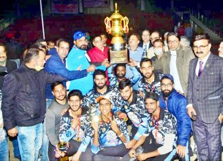 Jubilant KC Young Strikers team posing for a group photograph while receiving trophy from Mayor at MA Stadium Jammu.