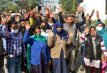 Members of Civic Safai Karamchari Union during a protest demonstration at Jammu on Wednesday.
