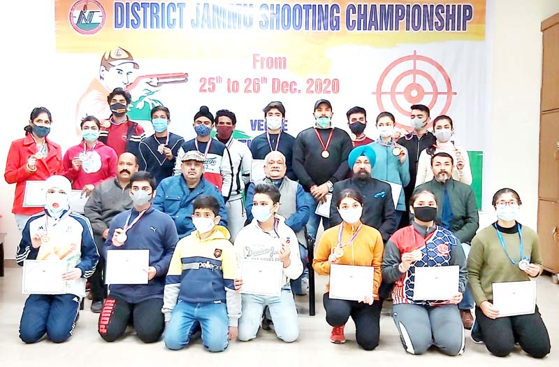 Chief guest and other officials pose with medal winners of Shooting Championship at Jammu on Saturday.