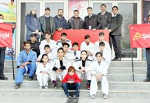 Judo players posing for a group photograph along with dignitaries outside Indoor Sports Hall of Polo Ground Srinagar.