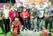 Winners posing for a group photograph along with their trophies at Jammu on Tuesday.
