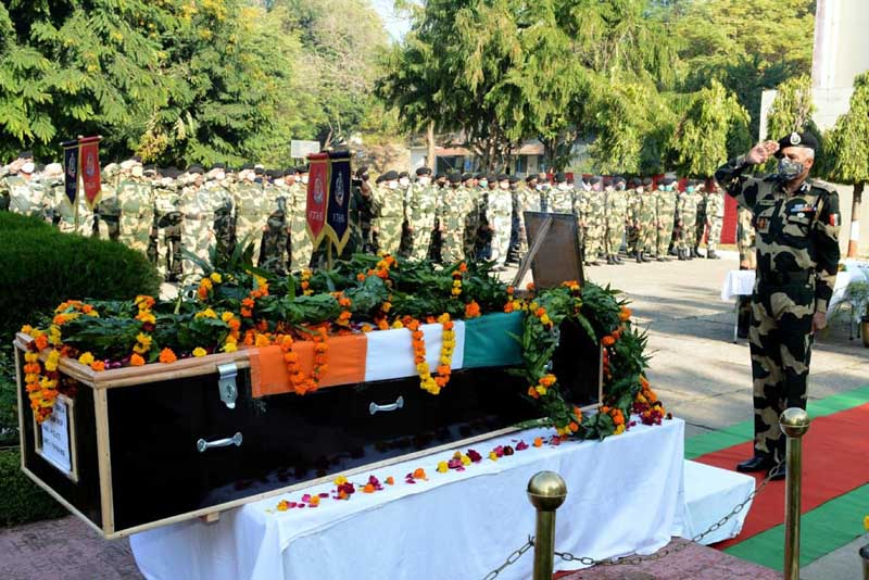 IG BSF Jammu N S Jamwal paying tributes to martyred officer at wreath laying ceremony on Wednesday. (UNI)
