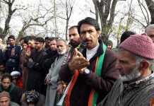 PCC chief G A Mir addressing a public meeting in Anantnag.