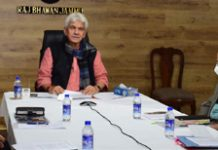 Lt Governor Manoj Sinha launching online services of Transport Department on Friday.