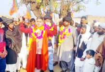 BJP J&K president, Ravinder Raina addressing a rally of Gujjars and Bakerwals in border belt of Jammu on Tuesday.