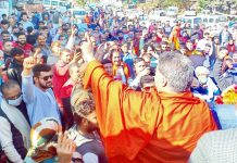BJP president, Ravinder Raina addressing a rally at Billawar on Wednesday. — Excelsior/Madan