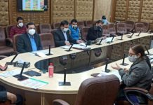 Advisor Baseer Khan chairing a meeting at Jammu on Tuesday.