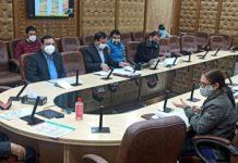 Advisor Baseer Khan chairing a meeting at Jammu on Tuesday.