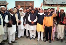 JKNPP chairman, Harsh Dev Singh along with supporters at a public meeting in Samba on Wednesday.