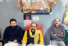 Pandit Rumil Sharma interacting with media persons at Jammu.
