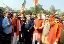 Former Deputy CM, Kavinder Gupta along with other BJP leaders during campaigning in Bhalwal on Wednesday.