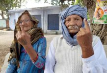 An elderly couple casts vote at Vijaypur-B segment in Samba district. -Excelsior/Abhishek Badyal