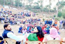 JKNPP leader Harshdev with party candidate Manju Singh during election rally at Khoon in Majalta on Friday.