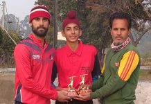 A player being awarded with man of the match award at KC Sports Club Jammu.