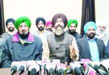 Veteran hockey players during a press conference at Press Club, Jammu on Tuesday.