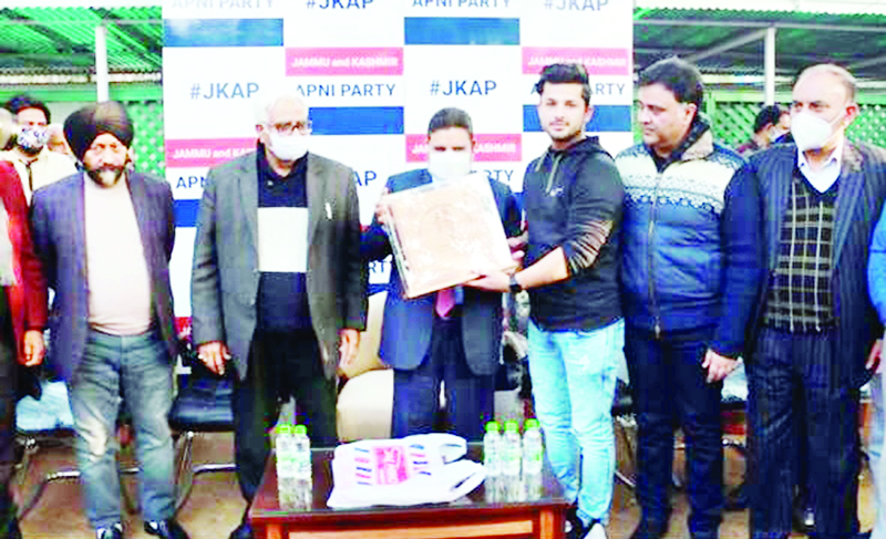 Apni Party president honouring awardee of Roller-skates at Jammu on Tuesday.