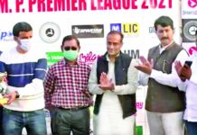 International Footballer, Arun Malhotra awarding a player during MP Premier League on Thursday.