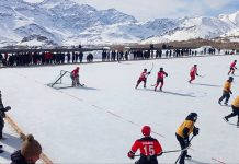 Players in action during Ice Hockey match at Kargil. —Excelsior/Basharat Ladakhi