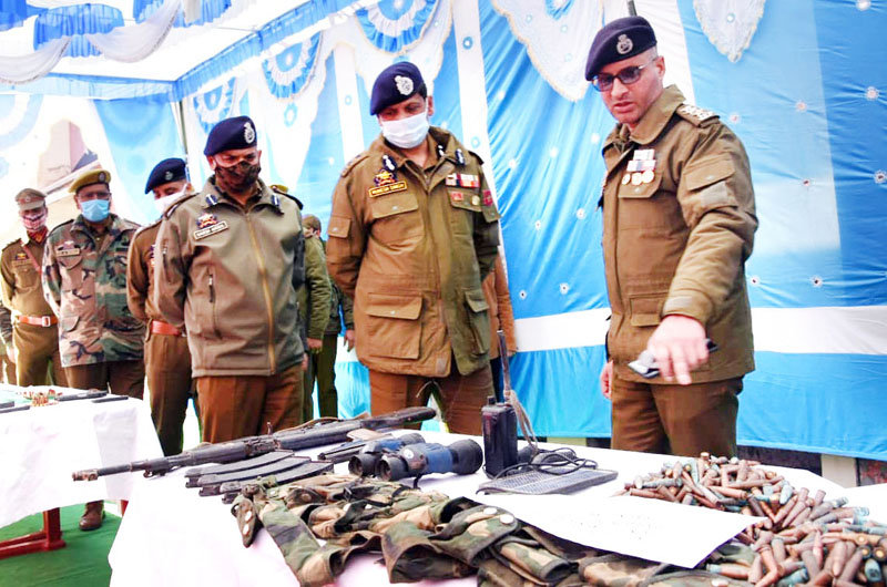 IGP Jammu Mukesh Singh inspecting arms and ammunition seized from militants in Mendhar on Monday. -Excelsior/ Rahi Kapoor
