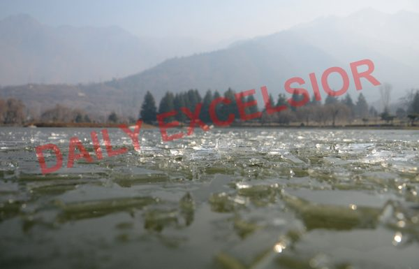 Parts of Dal lake freeze as temperature drops to minus 5.9 degrees celsius in Srinagar. — Excelsior/Shakeel