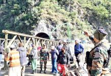 Chief Engineer BRO, Brigadier K Jaggi monitoring construction of bailey bridge at Kela Morh near Ramban on Thursday. -Excelsior/Photo