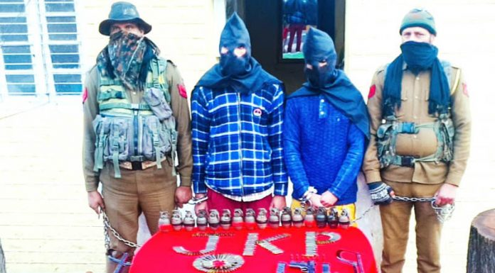 Militants arrested with arms and explosives in police custody at Ramban on Monday. -Excelsior/ Pervaiz Mir