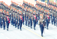 J&K Rifles contingent at Rajpath during the full dress rehearsal for the upcoming Republic Day Parade in New Delhi on Saturday.