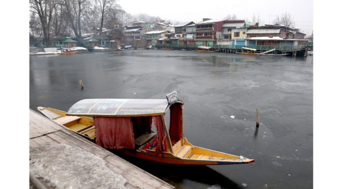 A boat moored on the banks of Dal lake as Srinagar records minus 7.2 degree temperature. —Excelsior/Shakeel