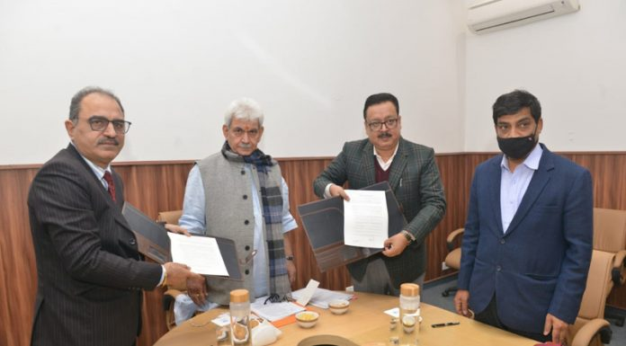 J&K Govt and NAFED officials sign MoU in presence of Lieutenant Governor Manoj Sinha in New Delhi on Friday.