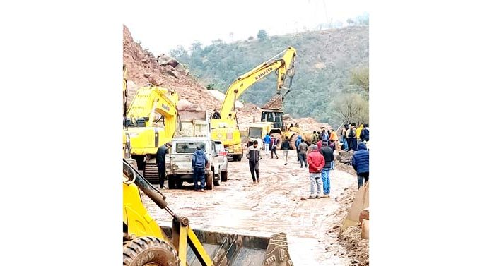 Work in progress to clear landslides at Samroli near Chenani on Jammu-Srinagar National Highway. -Excelsior/K. Kumar
