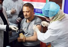 SKIMS Director Dr A G Ahanger gets first shot of COVID vaccine in Srinagar. — Excelsior/Shakeel