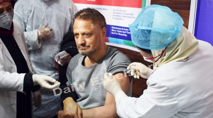 A health worker being administered COVID vaccine in Srinagar