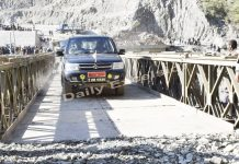Trial run being held on Bailey bridge at Kaila Morh in Ramban on Saturday. — Excelsior/Parvaiz Mir