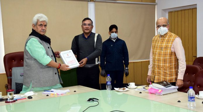 Lieutenant Governor Manoj Sinha launching PWD Engineering manual at the AC meeting in Jammu on Friday.