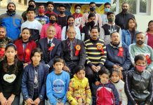 Participant climbers of camp posing for a group photograph with dignitaries at Bantalab.